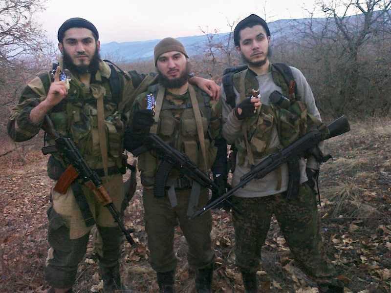In this undated photo provided by the Dagestani branch of the Federal Security Service William Plotnikov, right, poses for a photo. Security officials suspected ties between elder Boston bombing suspect Tamerlan Tsarnaev and the Canadian, an ethnic Russian named William Plotnikov, who had joined the Islamic insurgency in the region. Russian agents placed the elder Boston bombing suspect under surveillance during a six-month visit to southern Russia last year, then scrambled to find him when he suddenly disappeared after police killed a Canadian jihadist, a security official told The Associated Press. (AP Photo/Dagestani branch of the Federal Security Service via NewsTeam)