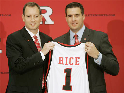 In this May 6, 2010, photo, Rutgers University Athletic Director Tim Pernetti, right, presents Mike Rice with a jersey after introducing Rice as the new men's head basketball coach.