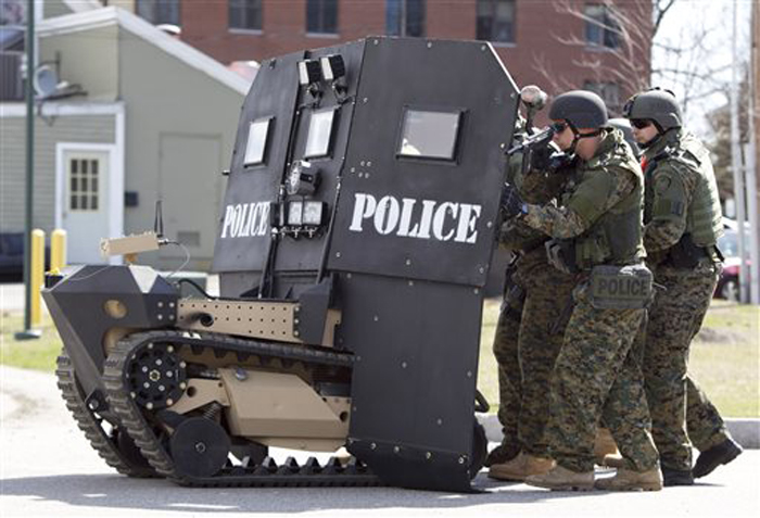 A remote-controlled small tank-like vehicle with a shield for officers, is demonstrated for the media in Sanford on Thursday, Howe & Howe Technologies, a Waterboro company, says their device can keep first responders safe in standoffs and while confronting armed suspects.