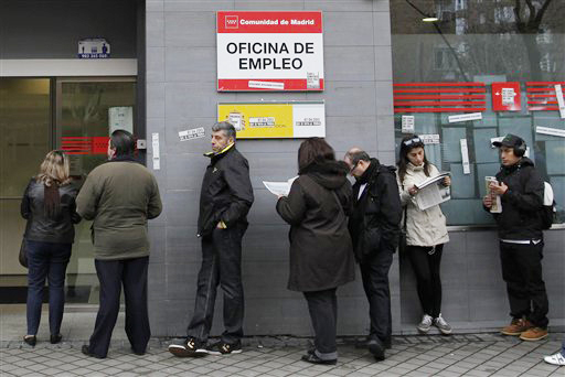 People wait outside an unemployment office in Madrid, Spain, on Tuesday. The number registered as unemployed stands at 5.04 million as Spain battles to emerge from its second recession in just over three years.