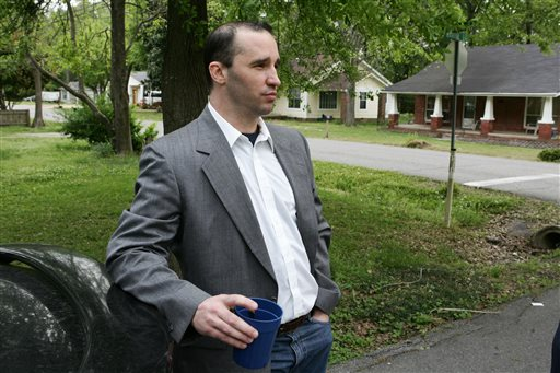 Everett Dutschke stands in the street near his home in Tupelo, Miss., and waits for the FBI to arrive and search his home in this April 23, 2013, photo.