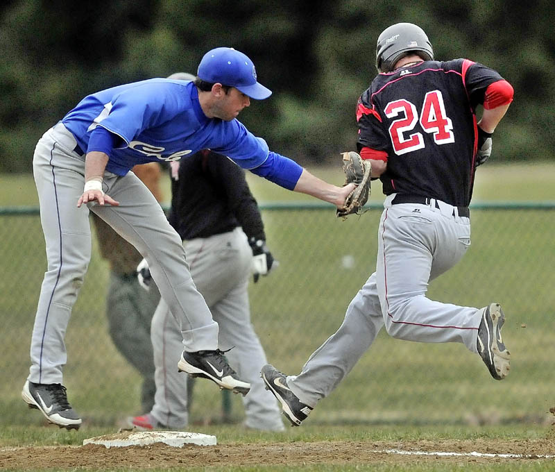 MAKE THE TAG: Colby College first baseman Kevin Galvin, left, tags out Thomas College's Thomas Cameron after jumping to save the ball from a bad thow in the fourth inning at Thomas College on Tuesday in Waterville.
