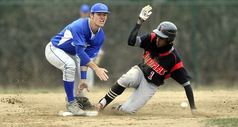 Colby College second baseman Tyler Starks, 1,left, loses his glove as Thomas College's Anree Benitez, 1, slides in to second base ahead of the ball on a steal in the fourth inning at Thomas College in Waterville Tuesday.