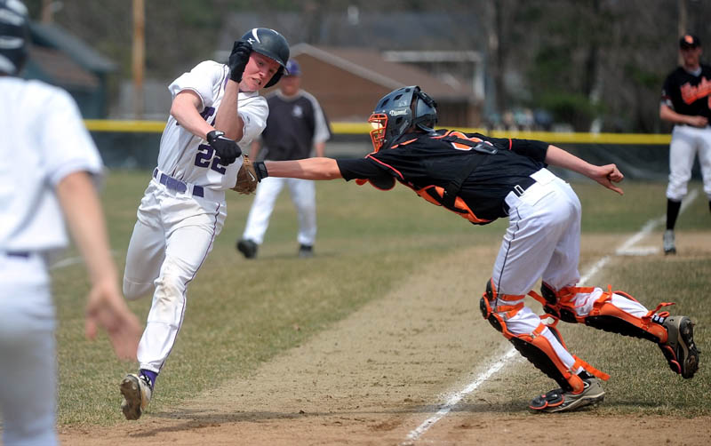Waterville Senior High School's Kaleb Kane, 22, evades the tag from Winslow High School catcher Bobby Chenard, 4, in the first inning Waterville Senior High in Waterville on Friday.