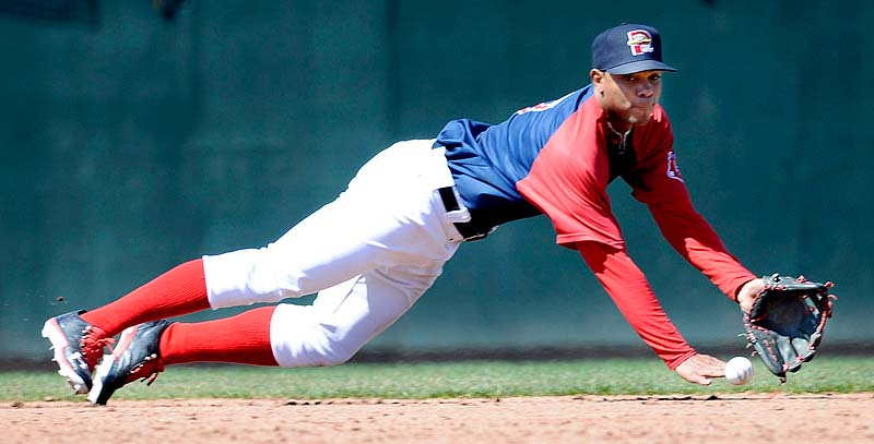 Portland shortstop Xander Bogaerts makes a diving grab in the third inning against the New Britain Rock Cats Sunday at Hadlock Field. Bogaerts was able to force a runner out at second base with a short toss from the ground.