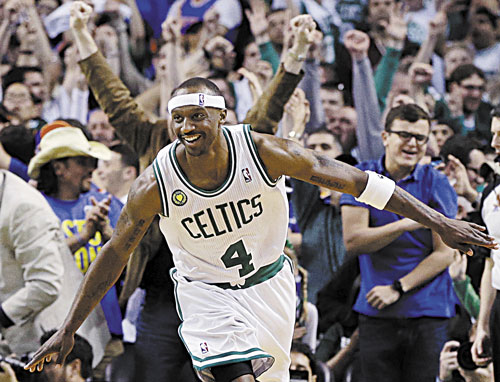 HANGING IN: Boston Celtics guard Jason Terry celebrates his basket against the New York Knicks during overtime of Game 4 of a first-round playoff series Sunday in Boston. Terry scored Boston's last nine points as they won 97-90.