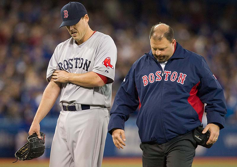 John Lackey walks off the field with trainer Rick Jameyson after he was injured in the fifth inning Saturday at Toronto. Lackey suffered a right biceps strain. Blue Jays;athlete;athletes;athletic;athletics;Canada;Canadian;Ce