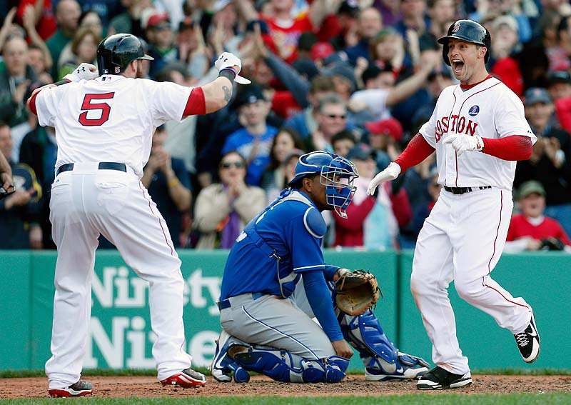 Daniel Nava, right, celebrates his three-run home run with Jonny Gomes as Kansas City catcher Salvador Perez looks on in the eighth inning Saturday at Fenway Park. The Red Sox won 4-3.