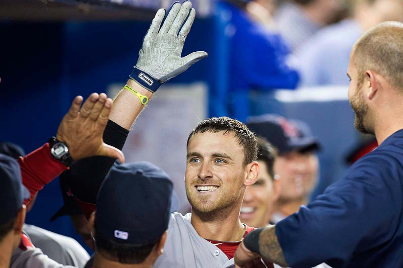 Will Middlebrooks celebrates in the dugout after hitting his third home run Sunday against the Blue Jays in Toronto. Boston won 13-0.