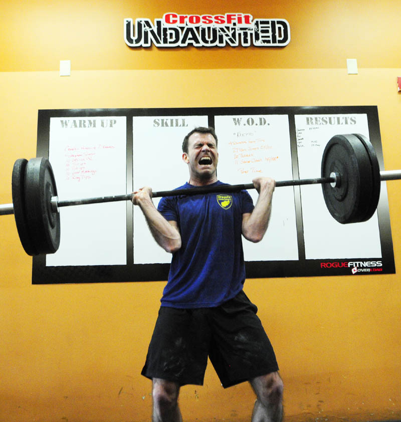 "Dan Phillips does a squat clean while performing the ""Klepto"" Hero WOD on at CrossFit Undaunted in Augusta."