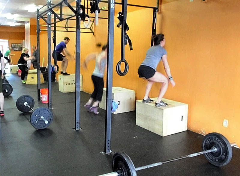 JUMP START: Crossfitters do box jumps at the start of the Klepto Hero WOD on Saturday monring at CrossFit Undaunted in Augusta. Staff photo by Joe PhelanCrossf 2013 at CrossFit Undaunted in A