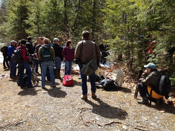 Journalists and neighbors wait to hike into Christopher Knight's camp.