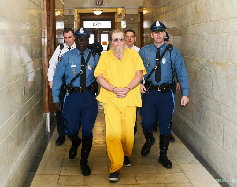 Massachusetts State Troopers lead convicted rapist Gary Irving into the Norfolk District Courthouse in Dedham on Monday for his first court appearance in Massachusetts since his capture last week in Gorham, Maine.