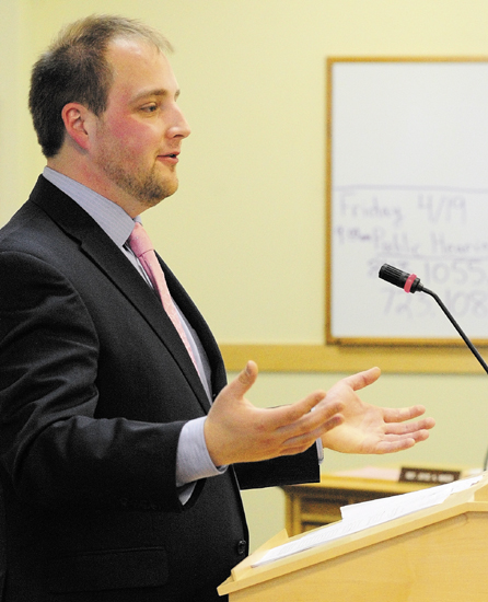 """Rep. Matt Pouliot, R-Augusta, introduces L.D. 843 """"An Act to Promote the Financial Literacy of High School Students,"""" on Friday during a meeting of legislature's education committee in Cross Building in Augusta."""