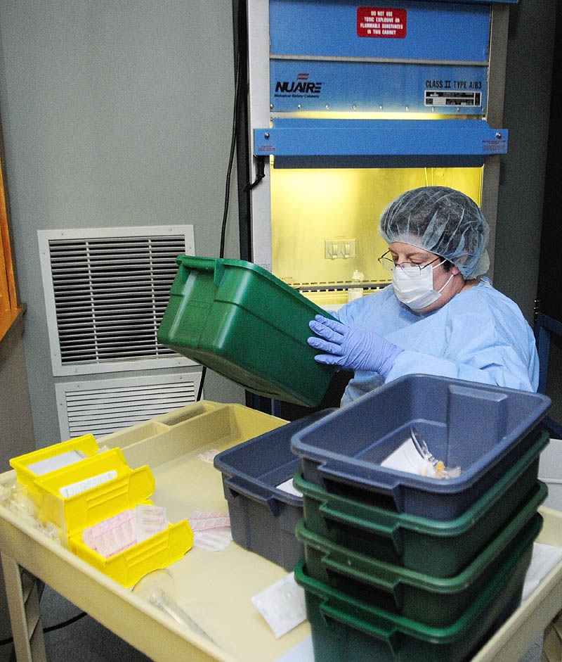 Pharmacy technician Suzanne Goddard prepares medicines in the sterile room on April 12, at Kennebec Pharmacy & Home Care in Augusta.