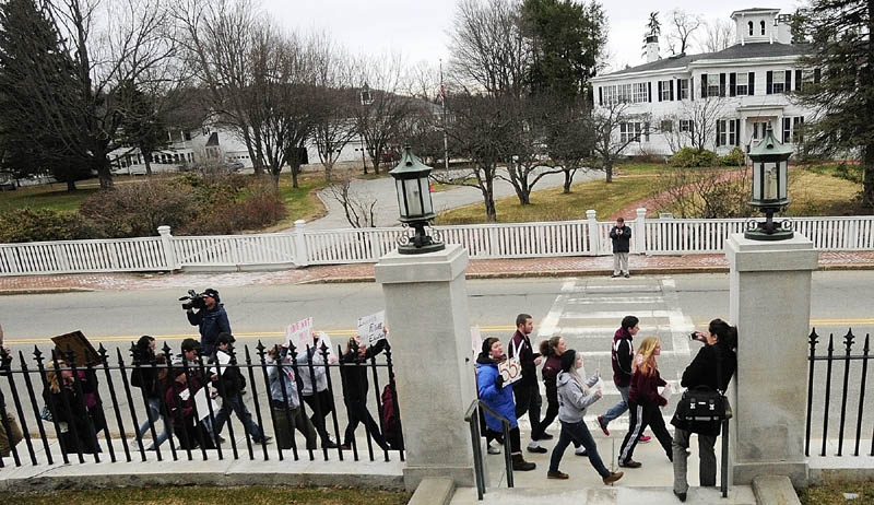 Students march along Capital Street between State House and Blaine House during a protest on Friday in Augusta.