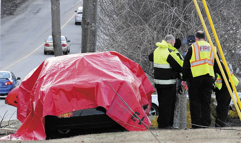 Augusta firefighters and police officers along with a Maine State Police trooper work at the scene of car accident around 6 p.m. Tuesday on Western Avenue, near the Brann Avenue intersection, in Augusta.