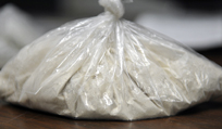 A bag containing more than 100 grams of heroin seized was Tuesday night at a Farmingdale apartment by Kennebec County Sheriff's deputies and agents from the Maine Drug Enforcement and the federal Drug Enforcement Agency.