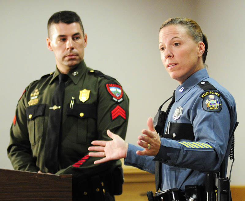 """Warden Service Sgt. Terry Hughes, left, and State Police Trooper Diane Perkins-Vance talk about capturing Christopher Knight -- known as the """"North Pond Hermit — during a news conference on Wednesday in Augusta."""