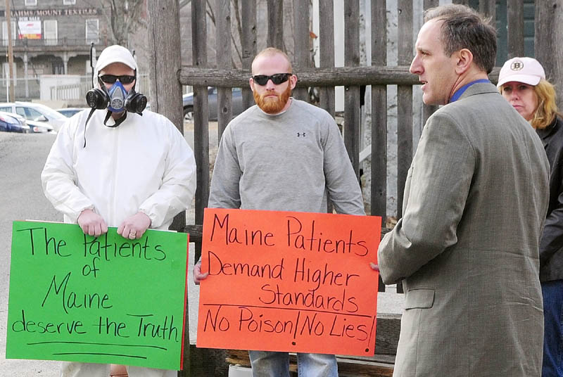 Brian Lee, who said he was a Wellness Connection patient, speaks during a protest on Friday in the middle of Dummers Lane in Hallowell. The Wellness Connection of Maine medical marijuana dispensary patient entrance is off Dummers Lane, which is an alley, next to the Liberal Cup, that runs between Water and Second Streets.