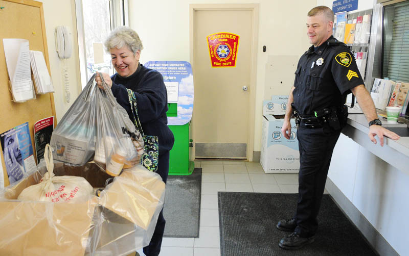 Carmen McCurdy, left, chats with Gardiner Police Sgt. Todd Pillsbury as she drops of medicine during the drug take back event in 2013 at the Gardiner police station.