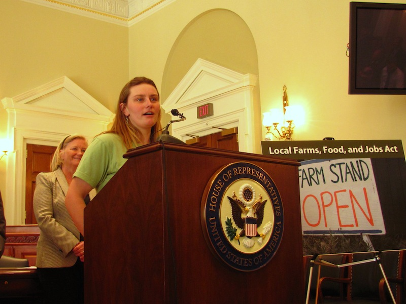 Sarah Smith, co-owner of Grassland Organic Farm in Skowhegan, speaks Tuesday, April 9, 2013 during a press conference in Washington D.C., during which Maine's U.S. Rep. Chellie Pingree (in background) unveiled a bill that aims to expand consumer access to products from local farms.