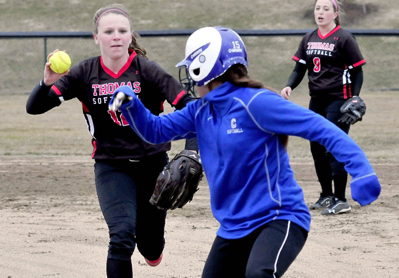 ON THE RUN: Thomas's Alyssa Eugley runs down Colby's Erica Pulford for the out during the Mules' 10-0 win Wednesday in Waterville. Julie Gustafson is at right.