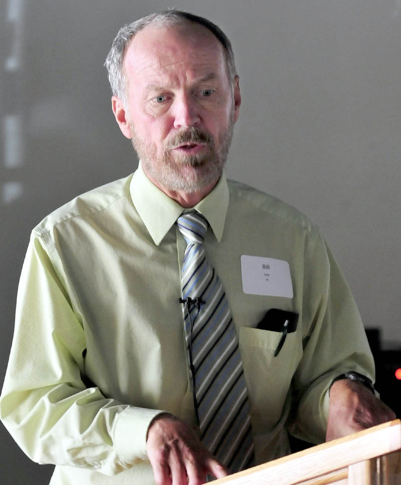 Bill Lee, who teaches at Colby College and is Waterville's city solicitor, talks to the Mid-Maine Global Forum on Tuesday about a trip he took recently with Colby students to Cuba.