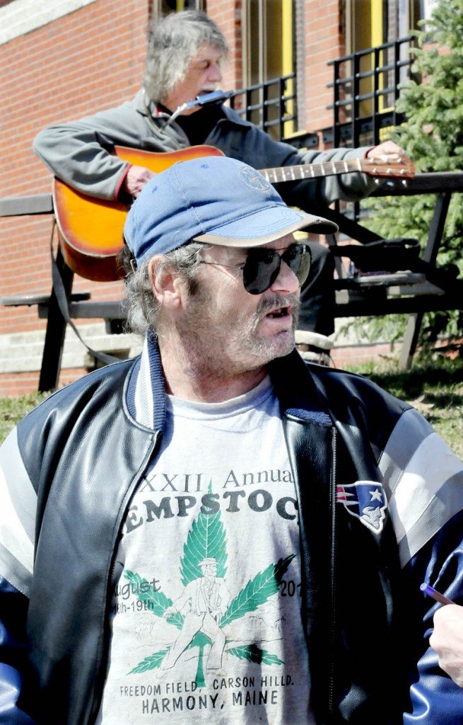 """Marijuana advocates Charles Hutchins Sr., front, and John White attended a Patriots Day """"smoke in"""" for marijuana legalization, outside the Somerset County courthouse in Skowhegan on Monday."""