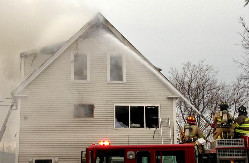Fire companies fight a blaze at a three-unit apartment building at 10 Maple St. in Fairfield Tuesday evening.