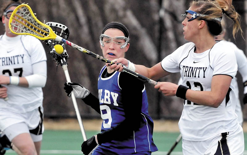 MOVE OVER: Colby College's Kirsten Karis tries to get by Trinity's Megan Leonhard during Sunday's game in Waterville.
