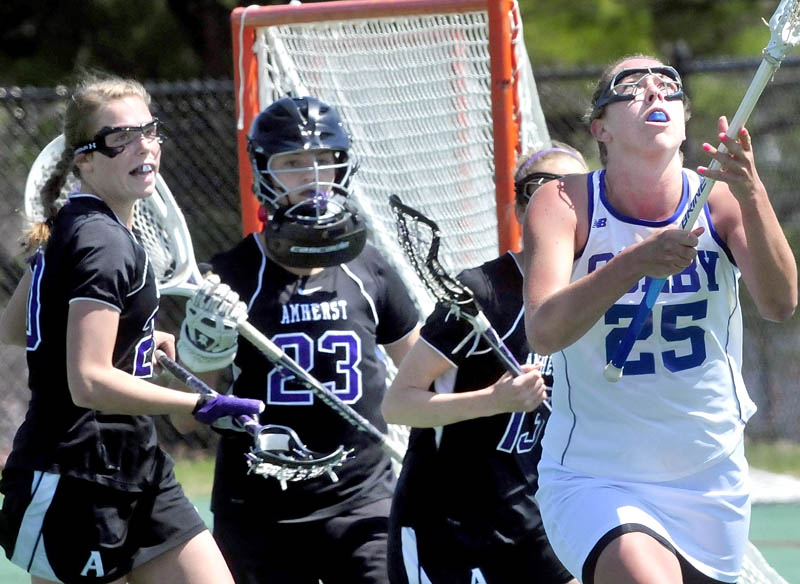 EYES ON THE PRIZE: Colby's Lindsey McKenna looks up for ball in air near Amherst College goalie Christy Forrest (23) during the Mules 11-3 win in a New England Small College Athletic Conference quarterfinal game Saturday in Waterville.