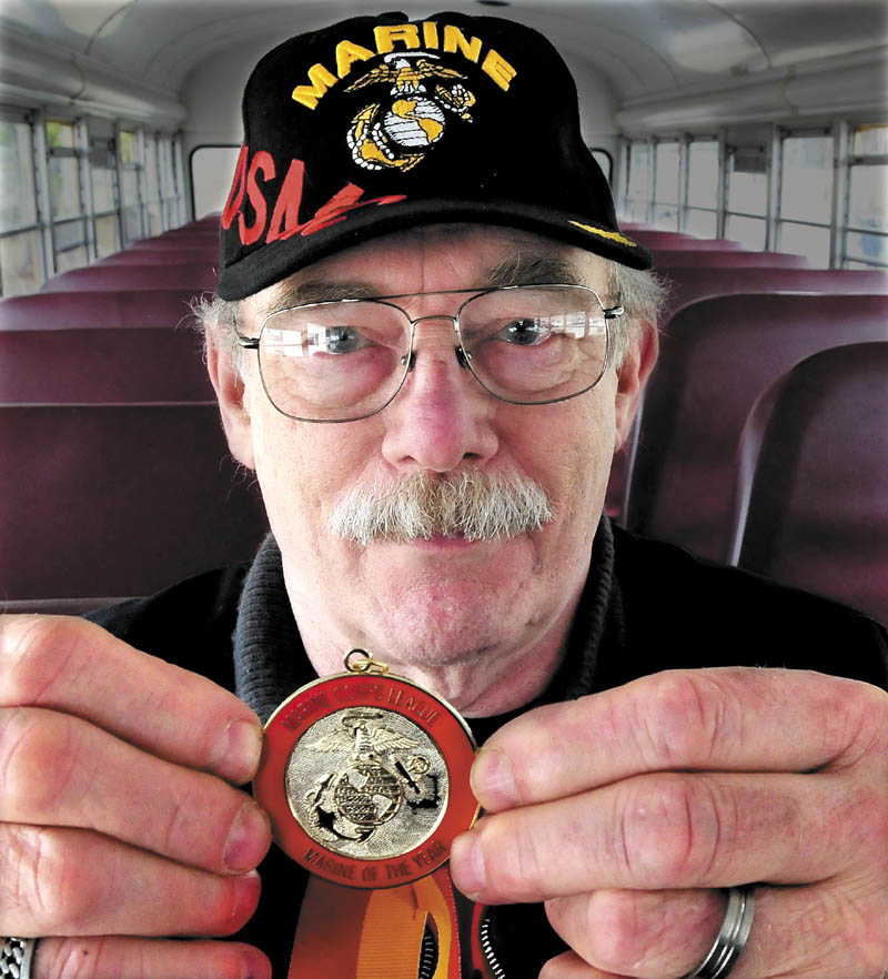 Richard Gordon, of Norridgewock, who served in the U.S. Marine Corp from 1957-1961, holds a metal he received after being named Department of Maine Marine of the Year.