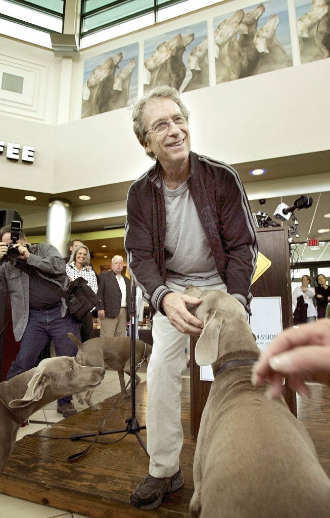 Photographer William Wegman is joined by his Weimaraners during the unveiling of his photographic mural in June of 2007.
