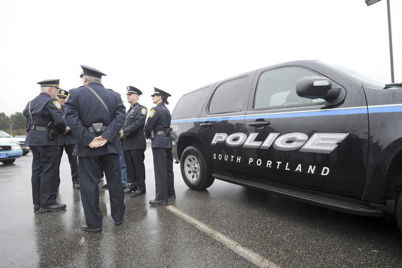 South Portland officers were among police officers from across Maine to assemble at Cabela's in Scarborough Wed. April24,2013 for the drive to Boston to honor Sean Collier, an officer at MIT, who was shot by one of the marathon bombing suspects.