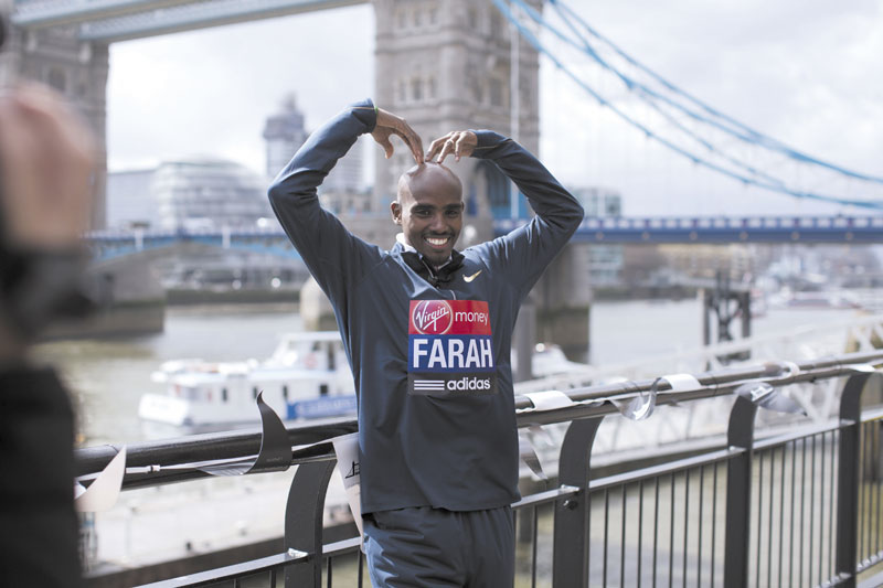 FEELING SAFE: Mo Farah, the reigning Olympic 5,000 and 10,000 meter champion poses for photographers during a media opportunity Thursday for the London Marathon near Tower Bridge in London. Farrah will run the half marathon in London.