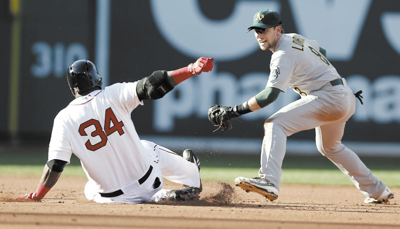 SAFE AT SECOND: Boston's David Ortiz slides into second with a double ahead of the tag by Oakland Athletics shortstop Jed Lowrie during the Red Sox' 6-5 win Wednesday at Fenway Park in Boston.