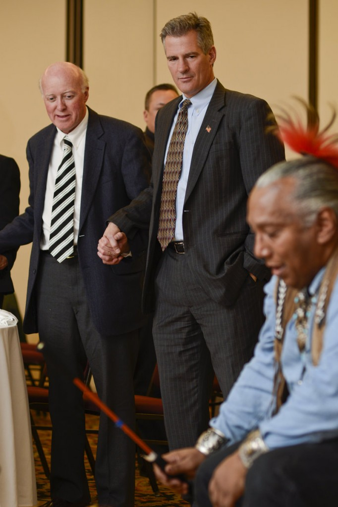 "Former U.S. Sen. Scott Brown of Massachusetts watches a traditional drum ritual of the Pequot tribe during the 11th Annual ""Keeping the Dream Alive"" dinner commemorating the anniversary of Martin Luther King Jr.'s death, Thursday, April 4, 2013 in Nashua, N.H. Declaring that he's likely not done with politics, former U.S. Sen. Scott Brown from Massachusetts refused Thursday to rule out a run for office in New Hampshire, while describing the Granite State as ""almost a second home."" (AP Photo/The Telegraph, Will Wrobel)"