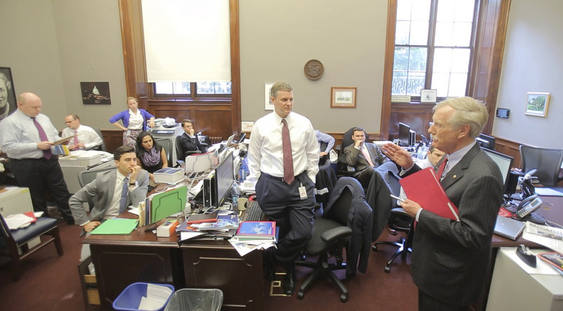 Sen. Angus King addresses members of his staff in their cramped, temporary office space in a basement room of the Russell Senate Office Building in Washington on Wednesday. The group of almost two dozen aides is hoping to move into bigger quarters by midsummer.