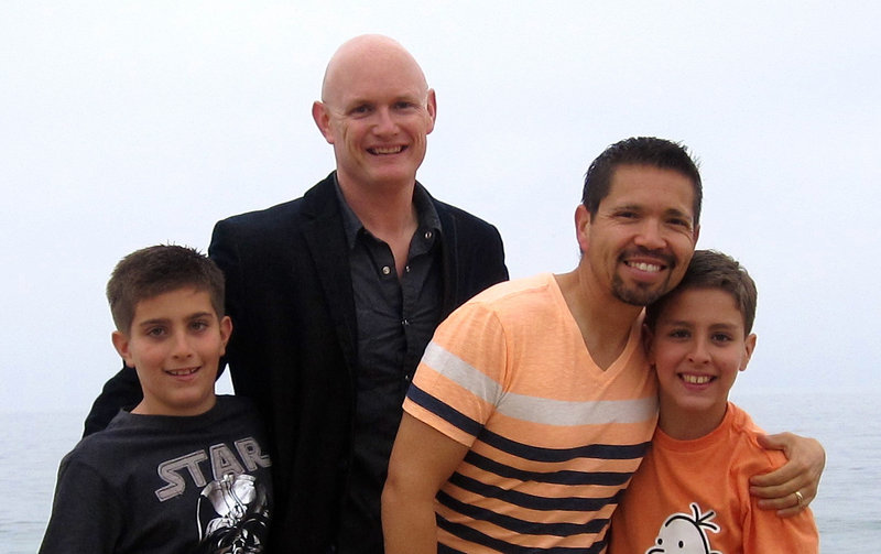 Kevin Covey, center left, and his husband, Joseph, stand with their twin 9-year-old sons Austin, left, and Dakota in Newport Beach, Calif. The federal government doesn't recognize the men's marriage under the 1996 Defense of Marriage Act, under review by the Supreme Court.
