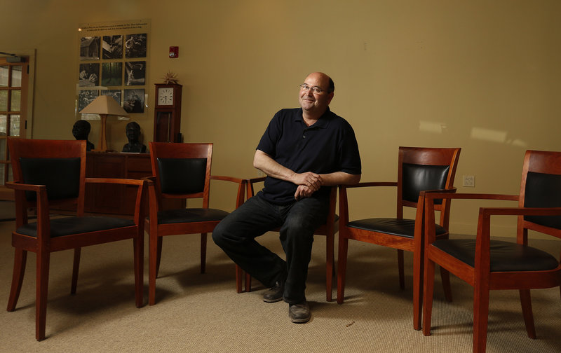Aaron Moser sits Thursday in a Harpswell chair, one of the Thos. Moser company's signature designs, at its headquarters in Auburn. He didn't learn until Wednesday that Harpswell chairs would be on the stage at Thursday's dedication of the George W. Bush library.