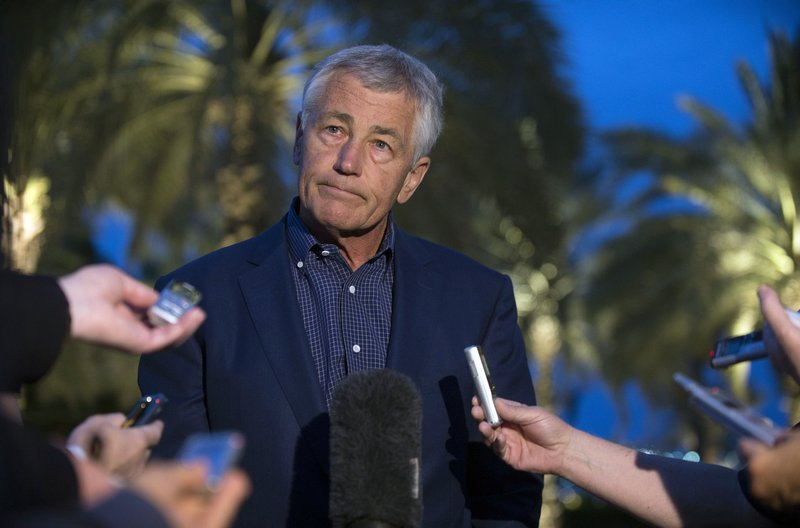 U.S. Secretary of Defense Chuck Hagel speaks with reporters Thursday after reading a statement on chemical weapons use in Syria in Abu Dhabi, United Arab Emirates.