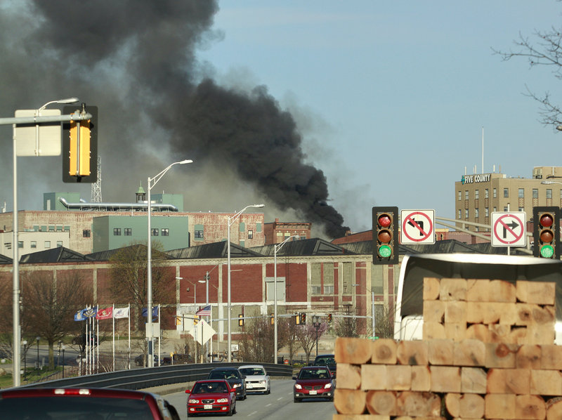 Smoke pours into the Lewiston skyline Monday. The Red Cross was on hand to assist people who lost their homes.
