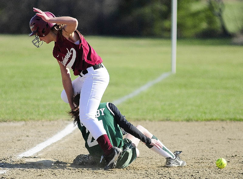 UP AND OVER: Richmond baserunner Autumn Acord, top, straddles Rangeley third basemen Michaela Shorey as they collide on a play Friday at Richmond High School.