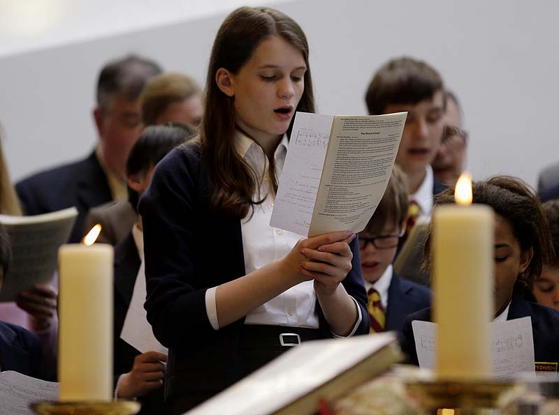 Annie Packard, 13, sings during Trinity Episcopal Church Sunday service at Temple Israel, which allowed the Trinity congregation to hold service in Boston. Trinity is within the blocked-off area near the finish line of the Boston Marathon, where earlier in the week two bombs exploded. Packard was in the grandstands when the first bomb exploded and ran away in the direction of the second bomb, which went off 10 seconds later.