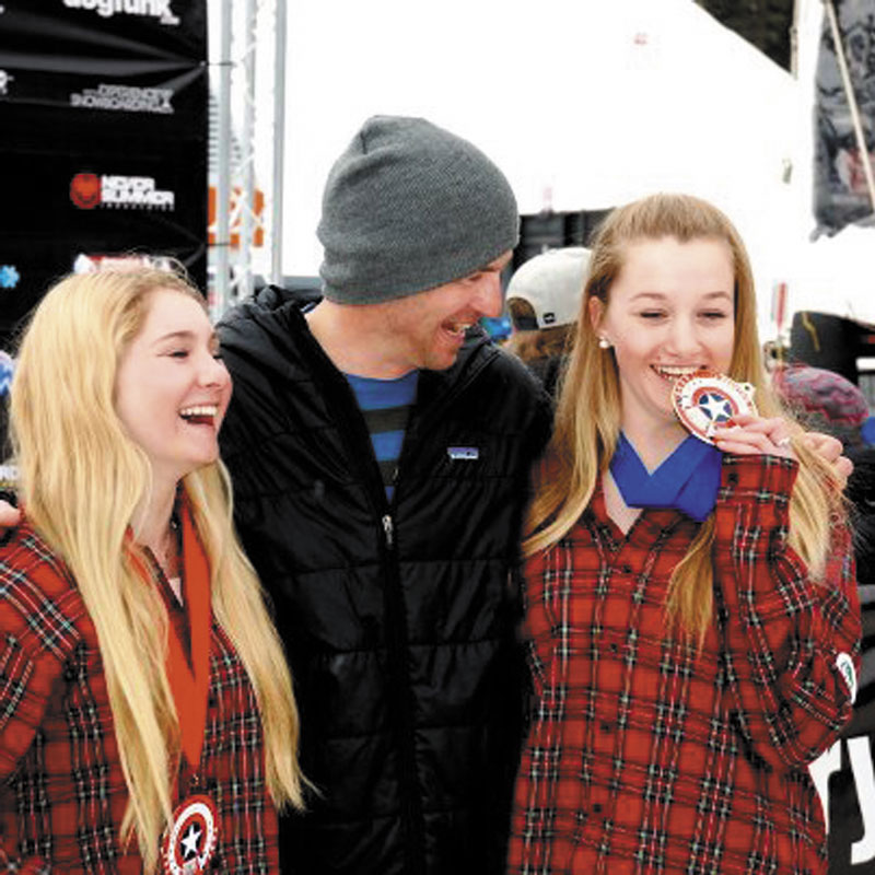 TASTE LIKE GOLD: Abi Zagnoli, right, celebrates with her coach, Mike Mallon , center, and Bianca Marcello after winning the girls 13-15-year-old age group skier-x title at the USASA Ski and Snowboard National Championships on Monday in Cooper Mountain, Colo. Marcello finished second.