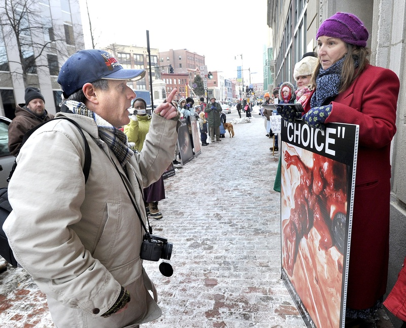 Pro-choice and anti-abortion protesters exchange words in front of the Planned Parenthood clinic at 443 Congress St. in Portland in January. A public hearing was held Thursday in Augusta on three abortion-related bills.