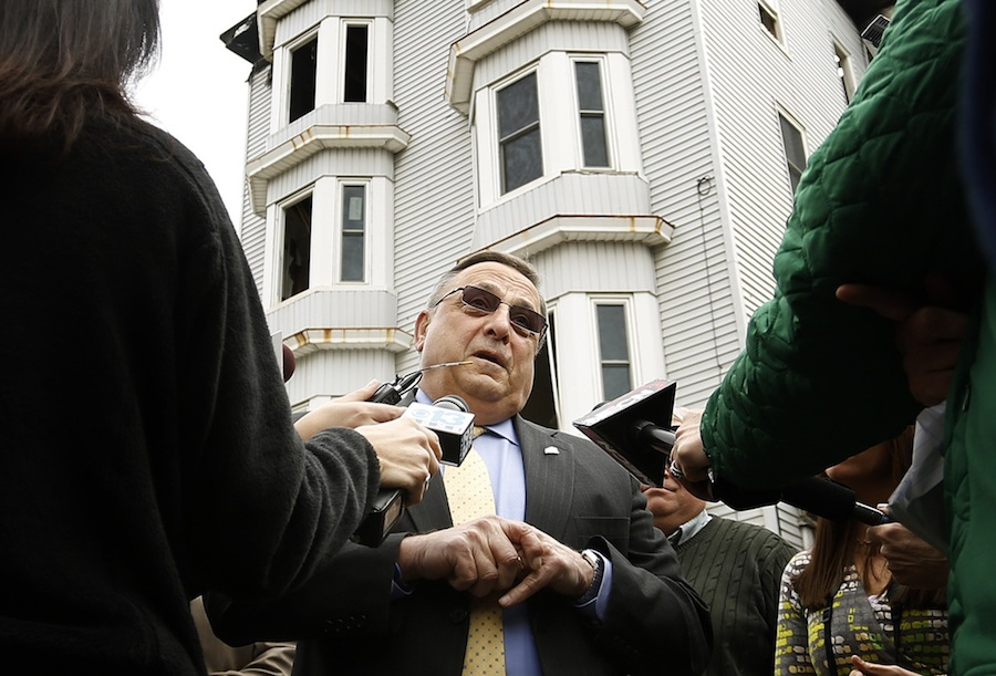 Gov. Paul LePage addresses the media Tuesday at the scene of the Bartlett Street fire in Lewiston.