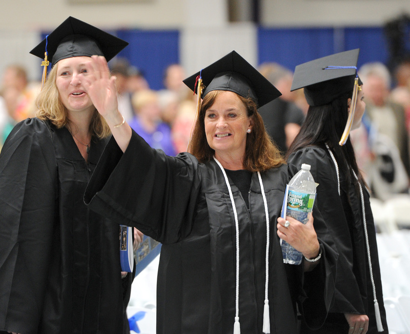 Elizabeth Murphy, of Kennebunkport, waves to family during Saturday's 133rd commencement at the University of Southern Maine in Gorham.
