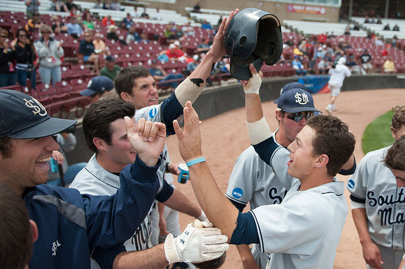 John Carey is welcomed back to the dugout after hitting a tiebreaking home run in the sixth inning. Carey was 3 for 5 with two RBI in a 7-2 victory over Webster, helping USM avoid elimination from the Division III World Series.